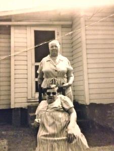 Bessie (Brumfield) Adkins stands behind Hazel Adkins, 1940s.