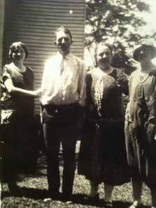 """Nora Pack Brumfield, Bob """"Jaker"""" Brumfield, Ethel Brumfield, and Jessie Brumfield, standing by the Charley Brumfield house in Harts, Lincoln County, WV, 1920s"""