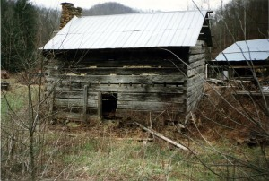 John Hartford took this photograph of an old cabin at Dingess in Mingo County, WV, March 1995
