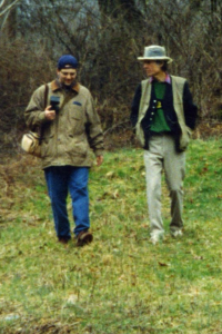 Brandon Kirk and John Hartford at the Laury Hicks grave, Calhoun County, WV, 1996