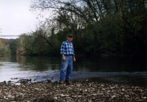 "Cecil Lambert standing on the ""green shoals"" of Guyandotte River, Lincoln County, WV, 1996"