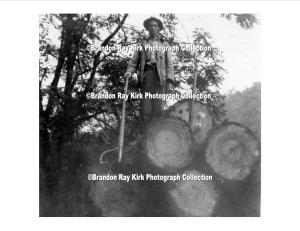 Cecil Brumfield, son of John and Harriet (Dingess) Brumfield, stands atop logs, Logan County, WV