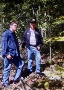 Jimmy McCoy with son at the Haley-McCoy grave on West Fork of Harts Creek, Lincoln County, WV, 1997