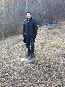 "Here I am standing at the Ward Brumfield grave, located in Harts. Around 2002, I helped to write a grant and placed a modern tombstone at Ward's grave, which was previously marked with a rock. Ward appears as a child in my book, ""Blood in West Virginia: Brumfield v. McCoy."""