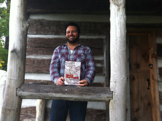 When traveling, I seldom miss an opportunity to introduce my book to a log cabin. Here we are at the Bailey Log Cabin in Bluefield, VA. October 2015